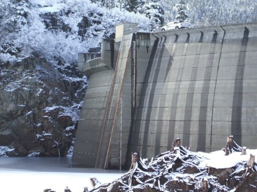 The Green Lake Dam, as seen in a 2008 file photo. As water levels begin to drop, the city has renewed its call for Sitkans to conserve electricity. (File photo)