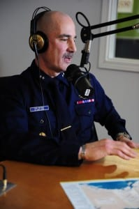 Rear Adm. Thomas Ostebo, Coast Guard District 17 commander, speaks to KJNO radio station listeners during a live interview Feb. 10, 2012. (USCG photo/Petty Officer 3rd Class Grant DeVuyst)