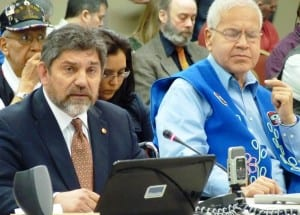 Kootznoowoo General Manager Peter Naoroz, left, addresses the Federal Subsistence Board Thursday during its Juneau meeting. Alaska Native Brotherhood subsistence leader Bob Loescher, right, listens. Photo by Ed Schoenfeld.