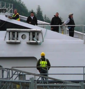 Fairweather crew members and shore staff get ready to tie up the fast ferry at Sitka's terminal. It and three other ships are slated to be tied up next year. (Ed Schoenfeld/CoastAlaska News)