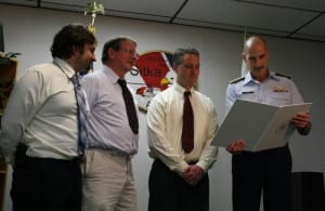 From left, Tyler Orbison, Gerald Gangle and Don Kluting receive a public service award from Coast Guard Rear Adm. Thomas Ostebo. The Sitka Mountain Rescue team members participated in a rescue in Nakwasina Sound in early 2012.