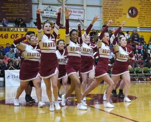 The Mt. Edgecumbe Cheerleaders leave the floor at halftime. (KCAW Photo/Robert Woolsey)