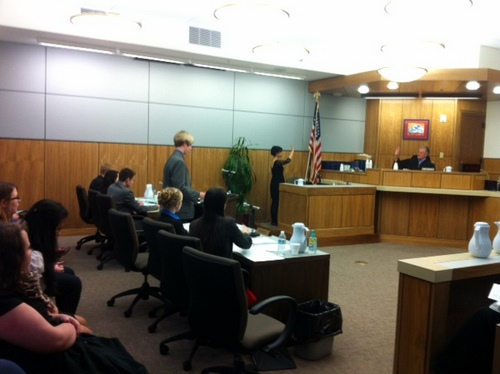 Sitka's Mock Trial Team in competition in Anchorage last week. Attorney Will Pate questions his first witness. Melea Roman and Alora Zellhuber seated to Pate's right. (Howard Wayne photo)