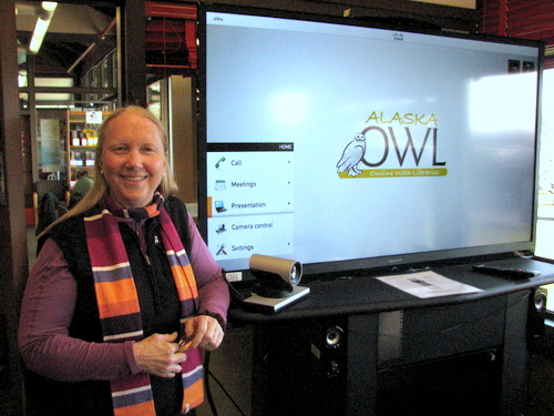 "Kettleson Library director Sarah Bell with the new videoconferencing system ""Online With Libraries."" (KCAW photo/Robert Woolsey)"