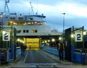 Passengers board the ferry Malaspina while vehicles wait to load at the Auke Bay terminal in Juneau. Travelers will no longer be able to take advantage of some discounts, due to budget cuts. (Photo by Ed Schoenfeld, CoastAlaska News)