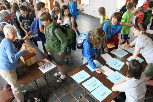 Middle school campers register for sessions inside Allen Memorial Hall at the Sitka Fine Arts Camp earlier this summer.  The nonprofit received a $10,000 grant from the City of Sitka. (KCAW photo by Ed Ronco)