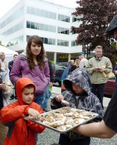 A family samples offerings at 2012's OysterFest. The shellfish came from a Haa Aani-supported oyster farm.