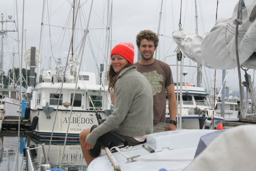 "Joanna Nasvik and David Leggitt are part of Coastal Footprint, a Juneau organization conducting beach cleanups in Sitka Sound and along parts of the outer coast. They're seen here aboard the 29-foot sloop ""Swifter,"" docked at Eliason Harbor on July 19. (KCAW photo by Ed Ronco)"