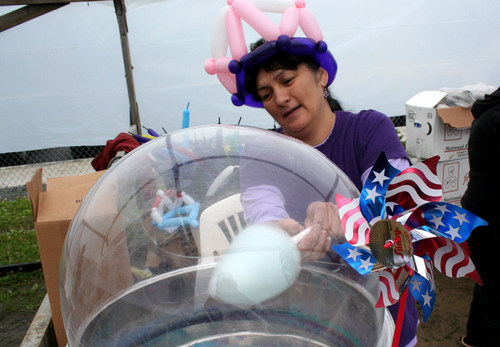 Jesse Notkong made cotton candy at Baranof playground during a rainy July 3rd afternoon. Food and game booths were set up for Sitka's Independence Day celebration.