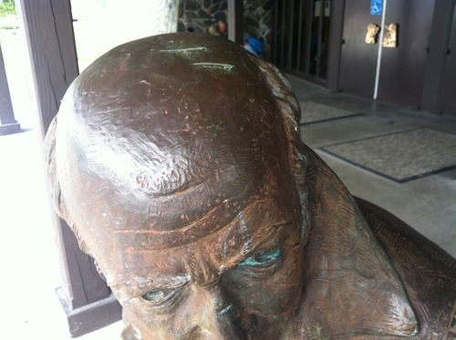 Police say vandals left a total of seven gouges on the Baranov statue's head and one on the bridge of its nose. In this photo, you can see two of the head gouges. (KCAW photo by Ed Ronco)