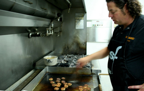 Chef Seth Caswell prepares grilled quinoa patties for the Sitka Seafood Fest this Friday and Saturday. Caswell is visiting Sitka from Seattle where he is, Executive Chef at Google.