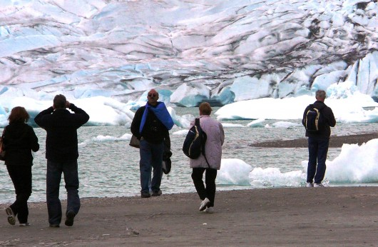 Cruise-ship tourists view Juneau's Mendenhall Glacier from a sand bar. The glacier is one of the most popular stops in the capital city.