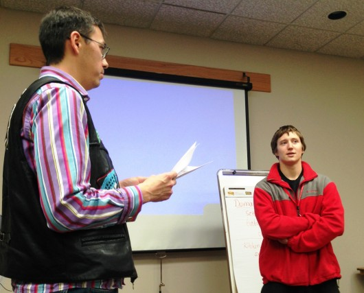 At the recent Tlingit Spelling Bee, Hans Chester gives winner Will Geiger a word. The bee was part of a games session during the November's clan conference in Juneau.(Ed Schoenfeld/CoastAlaska News)