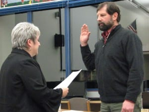 Municipal attorney Robin Koutchak administers the oath of office to Lon Garrison, who won a third term last month. His colleagues elected him board president again; Jen Robinson was named vice-chair. (KCAW photo/Robert Woolsey)
