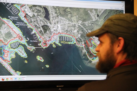 Matt Goff takes a look at the new tsunami inundation map created by the Alaska Earthquake Information Center. (KCAW photo/Rachel Waldholz)