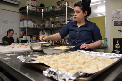 Pacific High Freshman, Oleana Valley makes lunch for her classmates as AmeriCorp volunteer Abby Long plans future recipes.