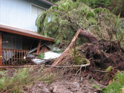 Heavy rainfall caused a landslide that moved this Cascade Creek home off its foundation. (KCAW photo/Emily Forman)