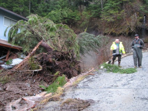 Brian Bickar and Troy Bayne helped reroute a creek in the Cascade Creek neighborhood to mitigate further damage. (KCAW photo/Emily Forman)