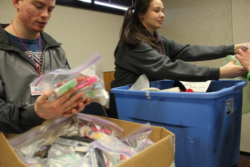 Mt. Edgecumbe High School seniors hand out socks and toiletries at Project Homeless Connect.