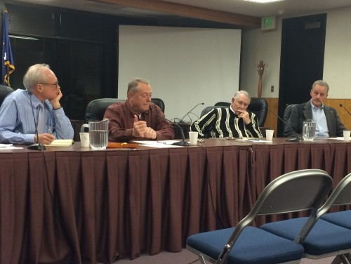 Sitka City Administrators past and present discuss the city's challenges at a live town hall meeting. From left to right: Mark Gorman, John Stein, Gary Paxton and Hugh Bevan. (KCAW photo/Rachel Waldholz)