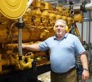 Yakutat Power's Scott Newlun talks about diesel generation at the community's diesel plant. (Ed Schoenfeld/CoastAlaska News)
