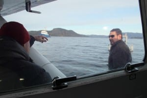 ADF&G biologist Dave Gordon disembarks from a float plane after an aerial survey of Sitka Sound, headed for the state research vessel, the Kestrel. (KCAW photo/Rachel Waldholz)