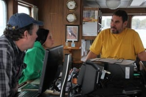 On board the R/V Kestrel, Dave Gordon (right) talks to other ADF&G biologists who have flown in from around Southeast to help manage the herring fishery. (KCAW photo/Rachel Waldholz)