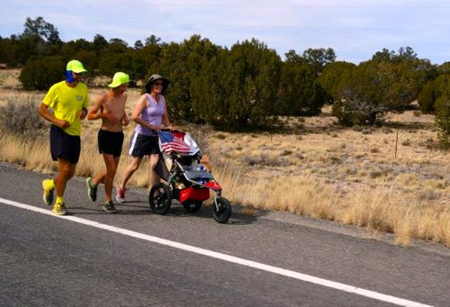 Brett, David, and Kris Wilcox on the run. The jogging stroller holds the provisions for their 20-mile days. (Russell Youngberg photo)