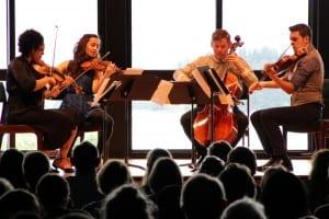 The Catalyst Quartet plays their arrangement of Bach's Goldberg Variations at Sitka's Harrigan Centennial Hall. From left: Jessie Montgomery, Karla Donehew-Perez, Karlos Rodriguez, and Paul Laraia. (Rachel Waldholz / KCAW)