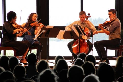 The Catalyst Quartet plays their arrangement of Bach's Goldberg Variations at Sitka's Harrigan Centennial Hall. From left:  Jessie Montgomery, Karla Donehew-Perez, Karlos Rodriguez, and Paul Laraia. (Rachel Waldholz / KCAW)