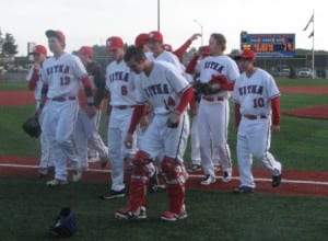 The Sitka Wolves baseball team comes off the field after clinching the Region V title. (KCAW photo/Robert Woolsey)