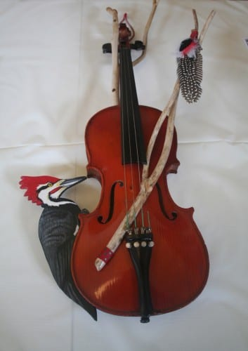 """Fiddle and Drum,"" a donated violin decorated by Laura Kaltenstein. Photo by Greta Mart."