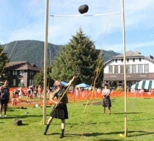 Alan Maloney competes in the sheaf toss at Sitka Seafood Festival's 2014 Highland Games, sending his bale over the 15 foot bar. (KCAW photo/Rachel Waldholz)