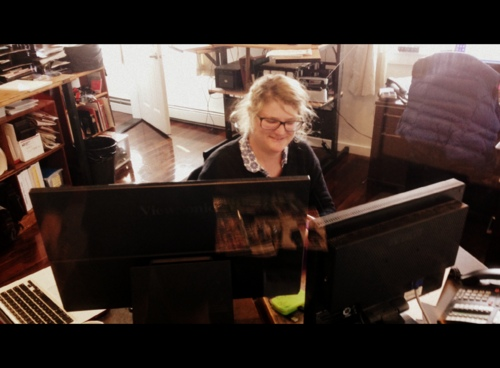 "KCAW summer news intern Greta ""Buzzsaw"" Mart hard at work on her last day. (KCAW photo/Robert Woolsey)"