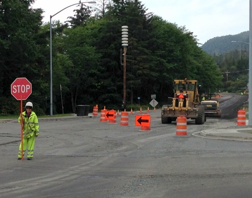 "Contractors roll out the CABC, or ""Crushed Asphalt Base Course,"" in preparation for paving HPR outbound from SeaMart. The DOT says the road will be finished -- or have a temporary surface -- by the end of the paving season mid-September. (KCAW photo/Robert Woolsey)"