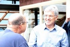 Democratic gubernatorial candidate Byron Mallott greets supporter Eric Jordan in Sitka on primary day, August 19, 2014. (KCAW photo/Rachel Waldholz)