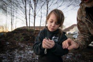 A student in the Sitka Conservation Society's 4H program holds a junco. (Photo by Bethany Goodrich, Sitka Conservation Society)