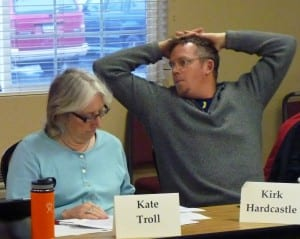 2-17-15 CROPPED Fisherman Kirk Hardcastle and Juneau Assemblymember Kate Troll review a report during the Tongass Advisory Committee meeting Feb. 17 in Juneau.