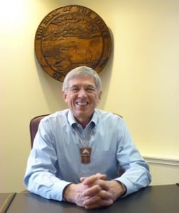 2-25-15 Lt. Gov. Byron Mallott sits at his desk, beneath the state seal 1 full