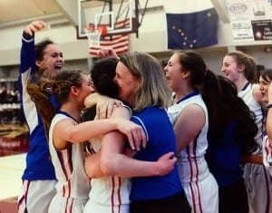 The Lady Wolves celebrate their regional win in Ketchikan, before heading to state in Anchorage. (Ingfrid Olney-Miller photo)