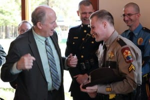 Governor Bill Walker (left) and VPSO Michael Gagliano after the governor signed his first bill, establishing Law Enforcement Officer Day. (Rachel Waldholz/KCAW)