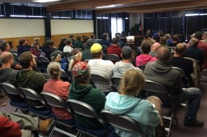 About 70 people gathered in Sitka's Harrigan Centennial Hall to hear from Dale Kelley, of the Alaska Trollers Association. (Rachel Waldholz/KCAW)