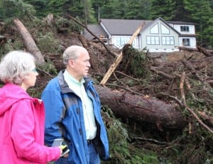 Gov. Bill Walker (right) and Sitka Mayor Mim McConnell visited the site of the Kramer Avenue landslide on Wednesday, August 19. (Rachel Waldholz, KCAW)