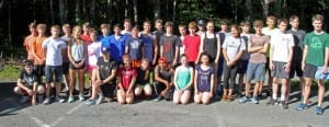 The Sitka boys and girls Cross Country teams pause for a photo a the beginning of their championship season. (KCAW photo/Charles Bingham)