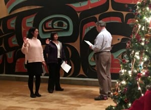 The Tribe's attorney, Alan Bell, swears in Lesa Way and Clara Gray to a two-year term on Tribal Council. (Emily Kwong/KCAW photo)
