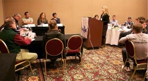 """Participants in the 2015 summit practice testifying  at a """"mock Board of Fisheries"""" training session."""