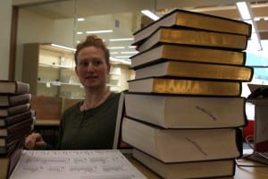 Library Brooke Schafer begins unpacking reference books. (Emily Kwong/KCAW photo)