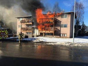 Sitka basketball players helped 11 occupants of this Anchorage six-plex escape the blaze. (Andy Lee photo)