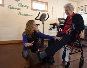 Haines physical therapist Marnie Hartman works with 92-year-old patient Marge Ward. Hartman said most of her business comes from people 65 and older. (Photo by Emily Files/KHNS)