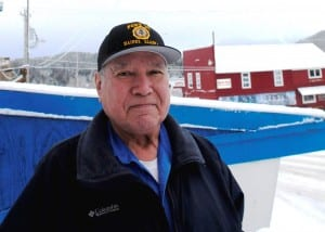 Ralph Strong, a 78-year-old Alaska Native veteran from Klukwan, poses outside the American Legion Hall in nearby Haines. (Photo by Jillian Rogers/KHNS)